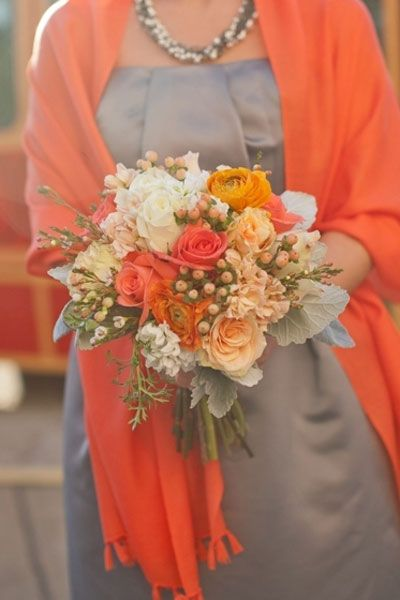 A beautiful textural bouquet including roses and hypericum berries. I love the depth in this bouquet its got so much interest and looks fab with the Grey/orange - would also go well with white/ivory Bridal dress and grey/orange Bridesmaids.