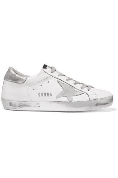 Golden Goose Deluxe Brand's 'Super Star' sneakers have been brushed and waxed by hand to give them the look and feel of old favorites. Crafted from supple leather, this white pair is decorated with the label's signature star appliqué. Wear yours at the weekend with a tee and pleated skirt.