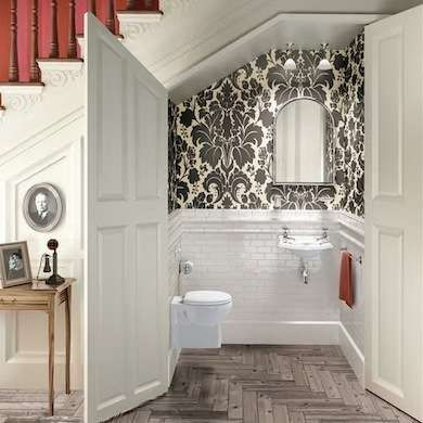 Petite Powder Room  Who wouldn't love an extra half bath? The space under your stairs can perfectly accommodate such a luxury. Elegant details, like the graphic wallpaper seen here, lend a sense of refinement to this cozy room.