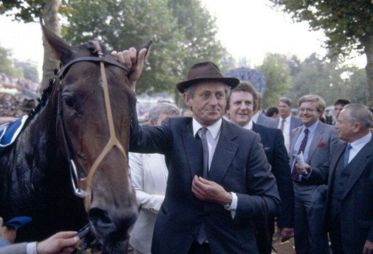 Dancing Brave with trainer Guy Harwood after his 1986 Prix de L'Arc de Triomphe win. No photo credit given.