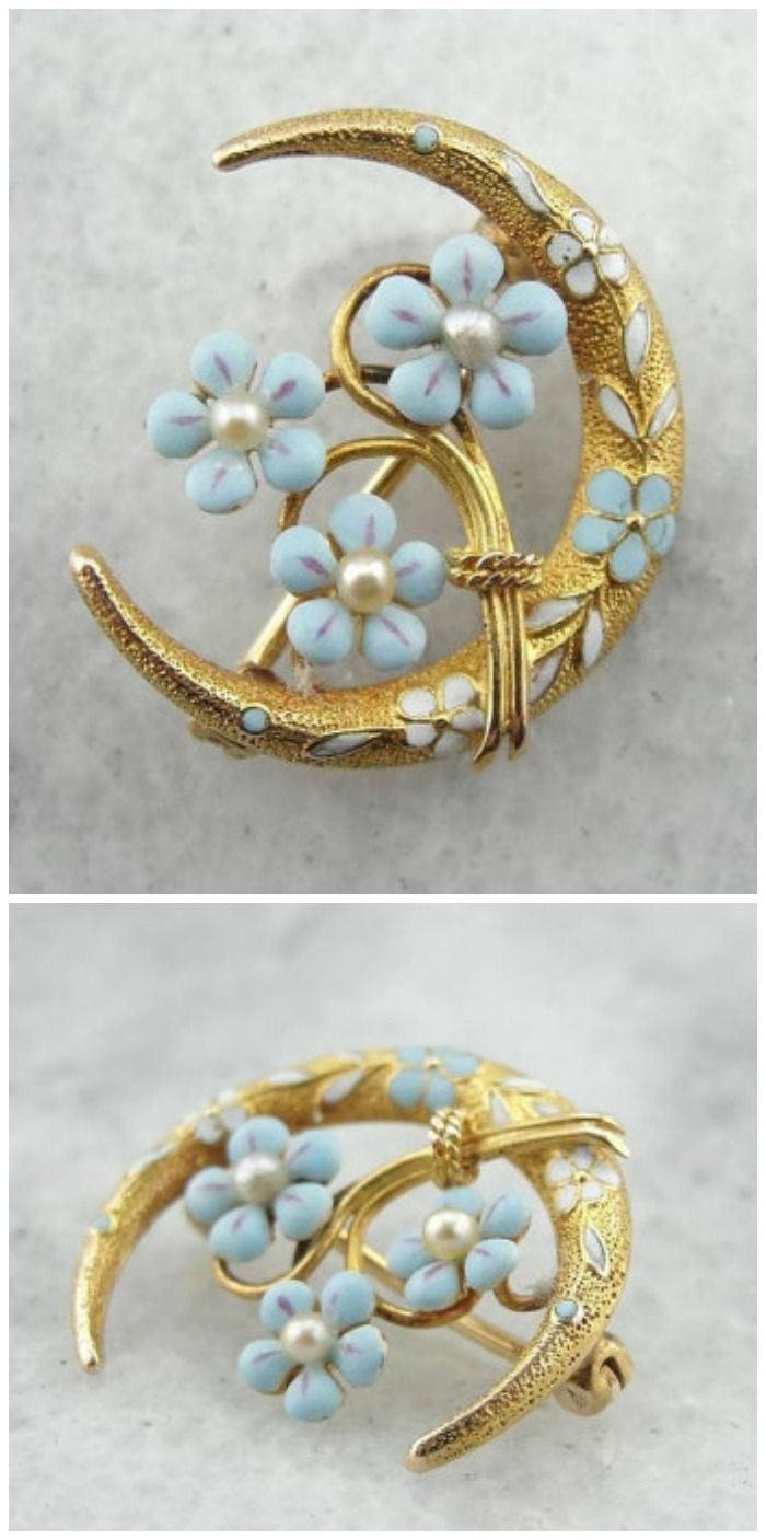 An antique honeymoon brooch with forget-me-nots in gold with enamel and pearls.