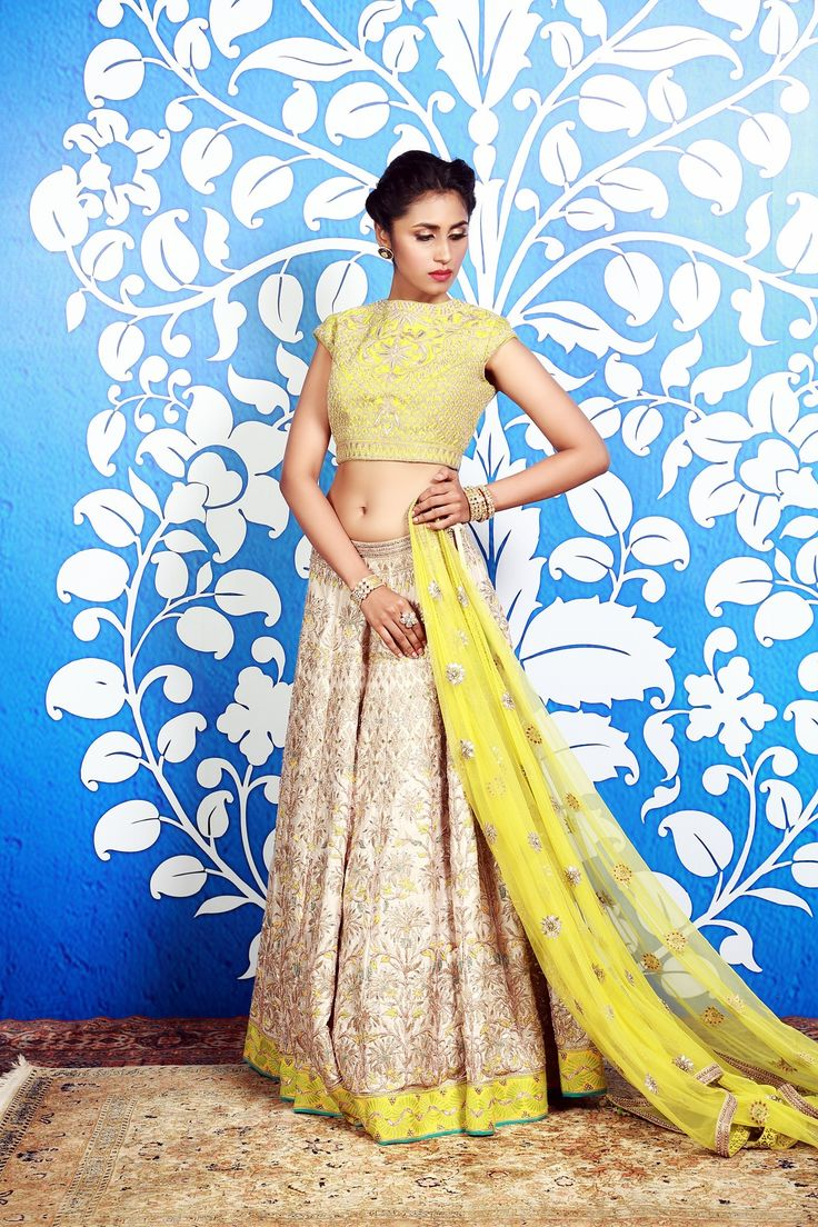 An exceptional sense of color and design brings to you this exquisite cream raw silk lehenga. Paired with a lime green embroidered choli, this ensemble is perfect for the young, trendy and confident modern woman