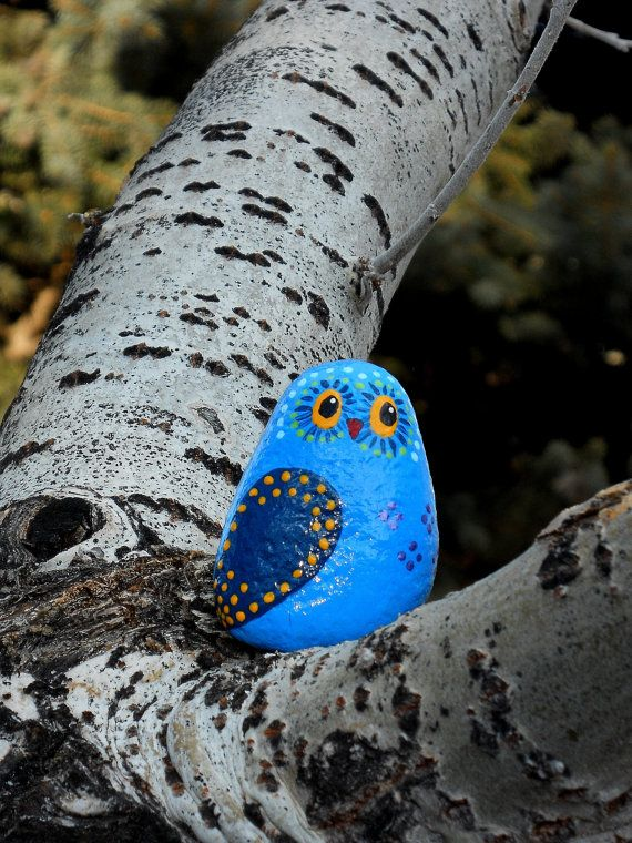 Whimsical owl in shades of blue hand painted on river rock on Etsy, $5.50