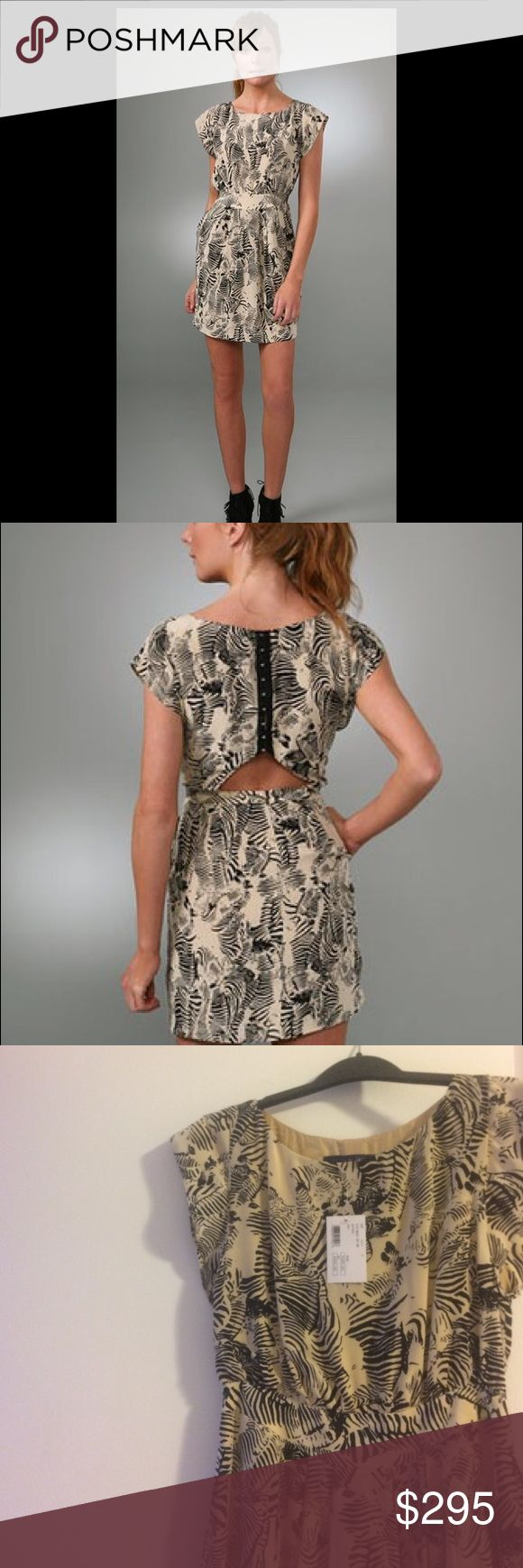 NWT Of Two Minds Zebra Print dress Zebra print dress. Retail price of $320. Cut out and clasped back Intermix Dresses