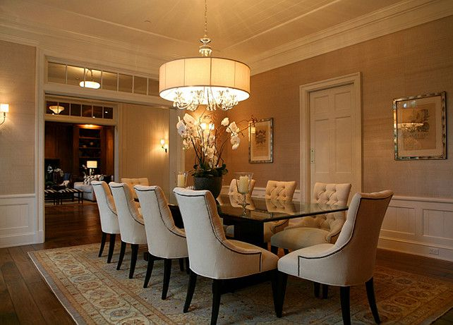 A dining room should always be inviting and comfortable. I prefer using upholstered chairs to make it feel more comfortable for guests and to add some texture to the space.  This particular dining room was beautifully decorated.