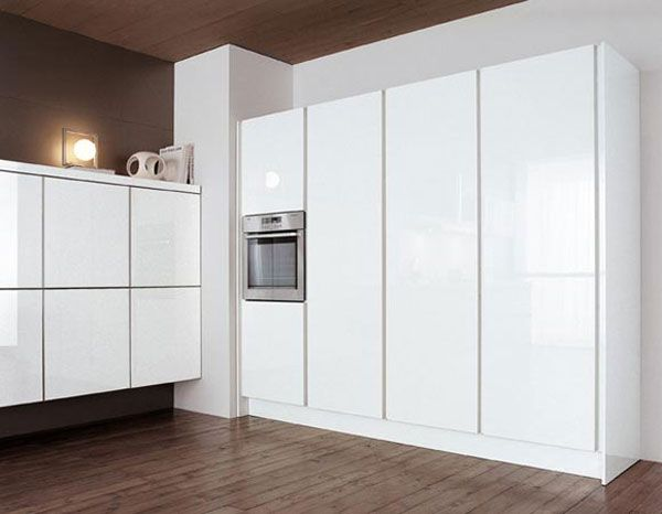 Floor and ceiling in wooden accent contrast with white for Kitchen units to ceiling