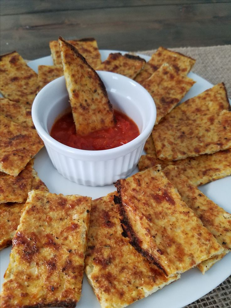 "Italian Cauliflower Cheesy ""Bread"" - We all try and eat healthier where we can, and should eat our carbs in moderation.  However, that's not always the case, and for me, cheesy bread is a weakness when it comes to pizza and pasta sides!  I mean, the ooey, gooey, cheese melting in your mouth is amazeballs!  However, my stomach is usually not a happy camper (nor my sewer system) after all of the cheese and bread."