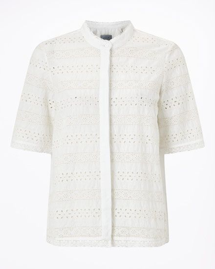 This cotton broderie shirt makes a new statement for the Spring season. Casually feminine, it is lightweight and features a concealed button placket. With soft pleats on the back, the design has been finished with pretty trims on the cuffs, neckline and hem. Tuck into a cropped pair of light wash (or white) jeans.