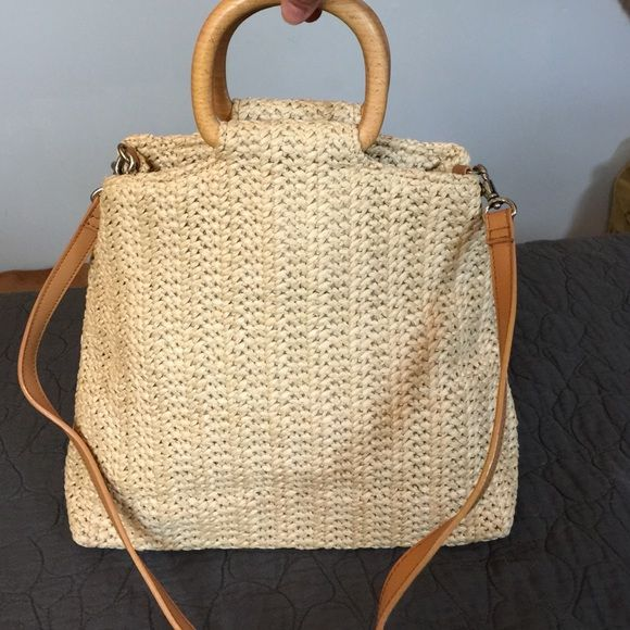 Fossil Rattan and Leather Bag Unique and beautiful Fossil bag made of macramé or rattan with wooden handles and removable leather strap.  This is a great summer bag that is sure to get you some attention.  There is a middle zippered compartment and a smaller inner zippered pocket.  This bag is in new condition. Fossil Bags Shoulder Bags