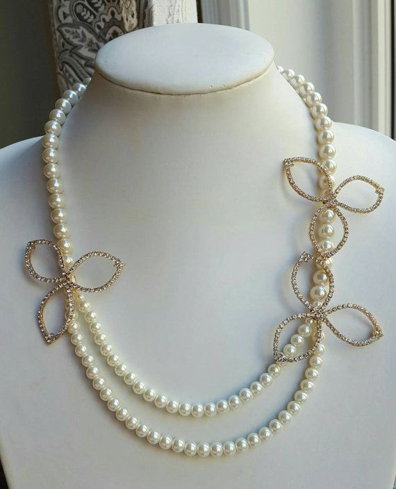 Check out this item in my Etsy shop https://www.etsy.com/ca/listing/475256562/multistrand-pearl-necklace-with