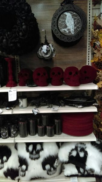 okay this is literally a picture of the classy Halloween section of Michael's thank god because those skulls are the coolest