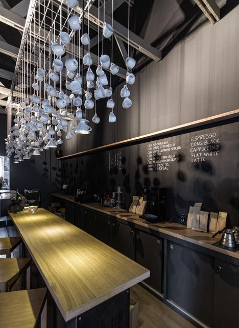 A long bar clad with raw metal sheets runs the entire length of the space, topped with a solid oak counter.