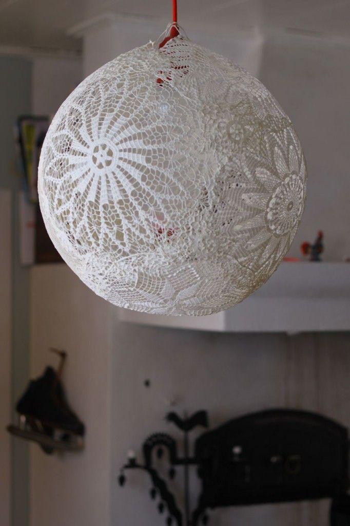 Lace balloon decoration/lamp. Blow up balloon, soak lace doilies in wallpaper glue, overlap onto balloon, add overcoat of glue, dry overnight, pop balloon to slowly deflate air, hang and enjoy! Can also add LED light to (safely) use as a lamp. Gotta try this!