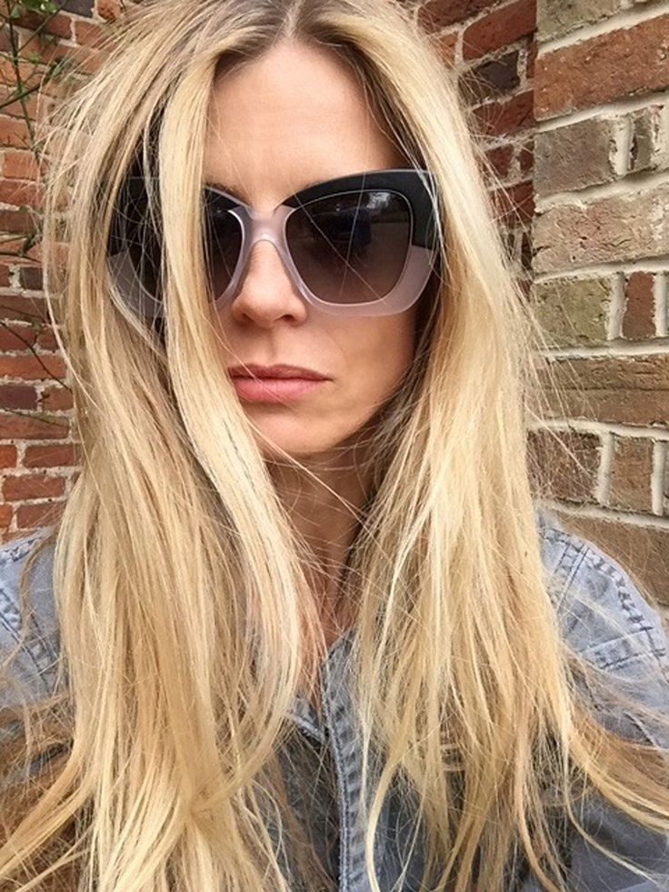 """March 17 - For a """"country selfie"""" in Oxfordshire, Laura pairs whopper-size and wonderfully subtle two-tone shades with denim and diamonds.  Cutler and Gross Black on Crystal sunglasses, $500 Cutler and Gross, NYC, 212.431.4440"""