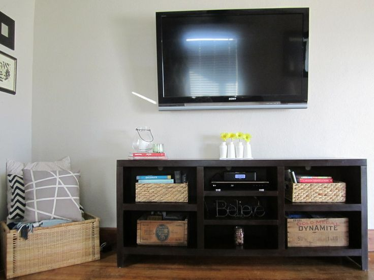 Attractive Table Under Tv With Wicker Baskets.