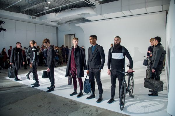 Models pose at the Uri Minkoff Presentation during NYFW: Men's at Dune Studios on January 30, 2017 in New York City.
