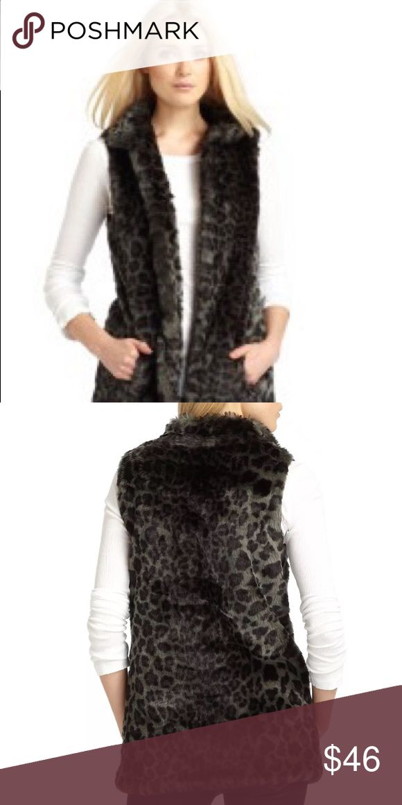 """NWT W118 by Walter Baker Black Vest Fur Sz M W118 by Walter Baker  Gorgeous Barry faux fur leopard vest 100% AUTHENTIC - NEW WITH TAGS RETAIL: $148 Color: Black Leopard Size: Medium Slip on the ultimate style statement. Super-soft and ultra-sexy, the faux fur vest takes your look to the next level. W118 designers stylishly created a longer length look High Neck Open Front Sleveless Side slash pockets Length 28"""" Dry clean only W118 by Walter Baker Jackets & Coats Vests"""