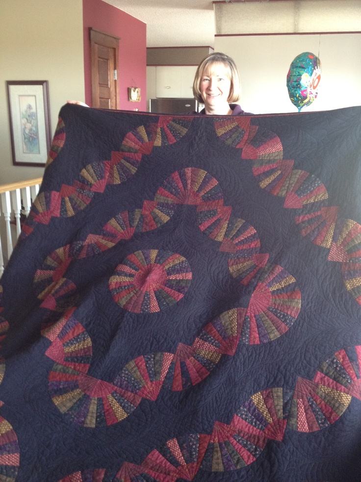 Gail's birthday quilt. The first time I've quilted free motion feathers of my own design.