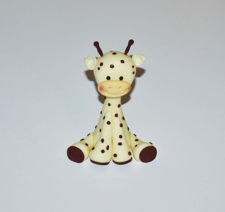 Cake decorating tutorial - how to make a fondant giraffe cake figurine -...