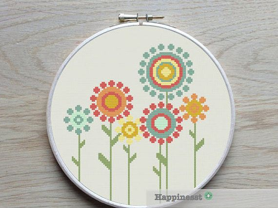 A modern flower cross stitch pattern in retro style.  Fits in a 8 inch embroidery hoop (14 count).  Buy 4 patterns and get 25% discount! Place 4