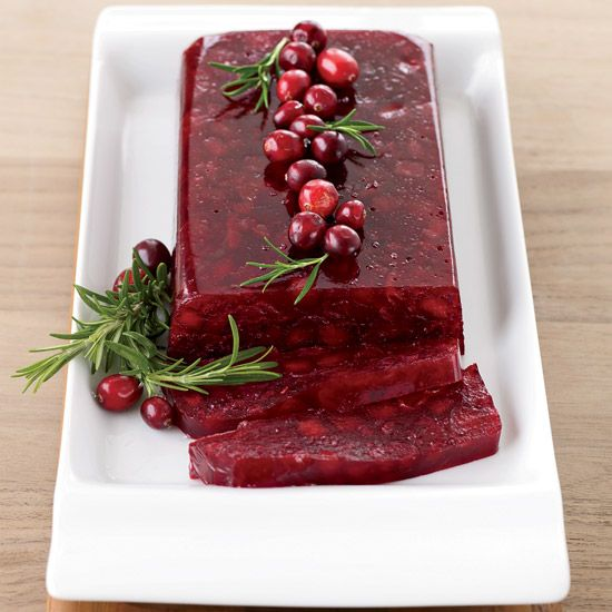 Jellied Cranberry Sauce with Fuji Apple | A classic take on cranberry jelly is updated with tart sliced apples.