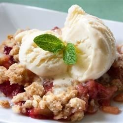 Slices of strawberry and rhubarb are topped with a buttery, brown sugar and oat crumble then baked until golden brown and crunchy.