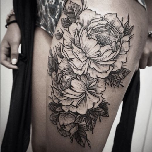 Rough-sided black-and-white flower tattoo on thigh