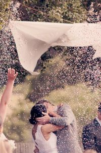 "When the officiant says, ""kiss the bride"" the maid of honour and best man pull the string and petals fall."
