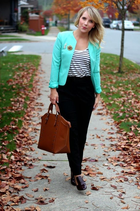 mint blazer with rolled up sleeves, TWO brooches! Love the leaf next to the bigger one.