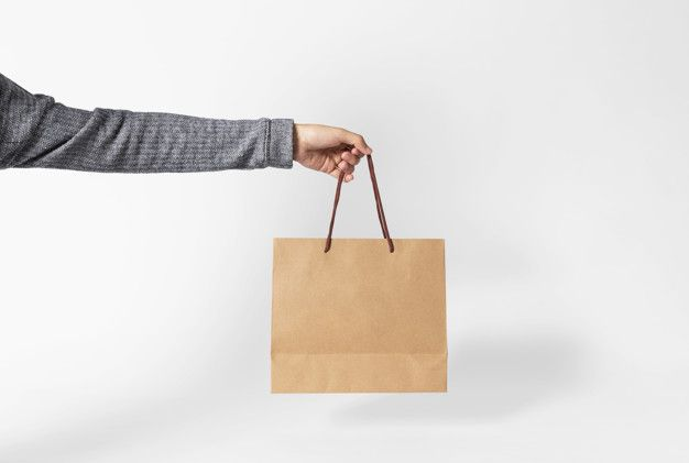 Hand Holding Blank Brown Paper Bag For Mockup Template Advertising And Branding On Gray Background Brown Paper Bag Gray Background Bag Mockup