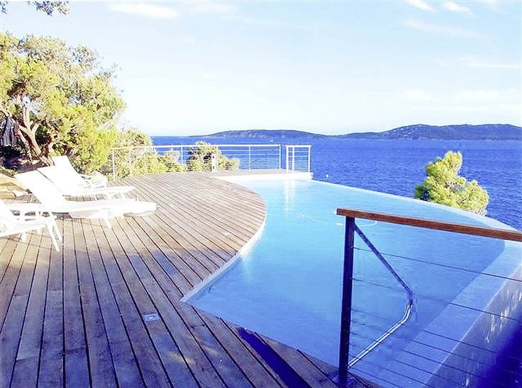 Villa Lecci Corsica Sleeps up to 8. With splendid sea views from the exceptional swimming pool terrace, and exclusive access to a romantic sandy cove, this luxury villa in Corsica sits right at the water's edge.