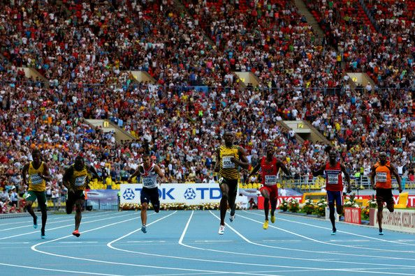 Churandy Martina Usain Bolt of Jamaica crosses the line to win gold ahead of (L-R) Anaso Jobodwana of South Africa, Nickel Ashmeade of Jamaica, Adam Gemili of Great Britain, Curtis Mitchell of the United States, Jaysuma Saidy Ndure of Norway and Churandy Martina of the Netherlands in the Men's 200 metres final during Day Eight of the 14th IAAF World Athletics Championships Moscow 2013 at Luzhniki Stadium on August 17, 2013 in Moscow, Russia.
