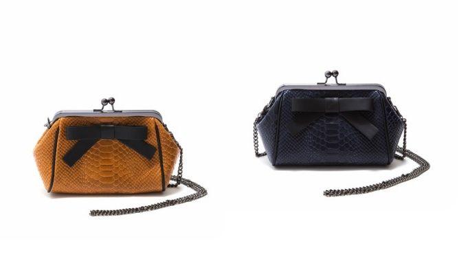 Feminine and sweet! Carla Ferreri clutch bag at: https://storebrandsvip.com/b2b/products/?brand=4&category=2