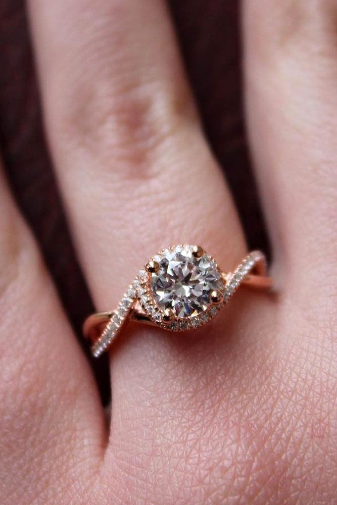 27 Rose Gold Engagement Rings That Melt Your Heart ❤️ rose gold engagement rings twisted band round cut diamond ❤️ See more: http://www.weddingforward.com/rose-gold-engagement-rings/ #wedding #bride #engagementrings #rosegoldengagementrings