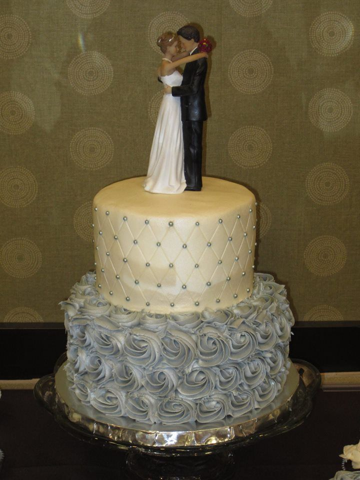 2 tier silver and white wedding cake with silver ...