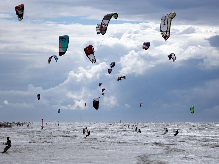 Kite surfers enjoy their sport at the North Sea near Sankt Peter-Ording, Germany.  Axel Heimken, EPA