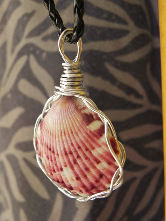 Pink and White Wire Wrapped Spotted Shell on Black Braided Cord. $15.00, via Etsy.