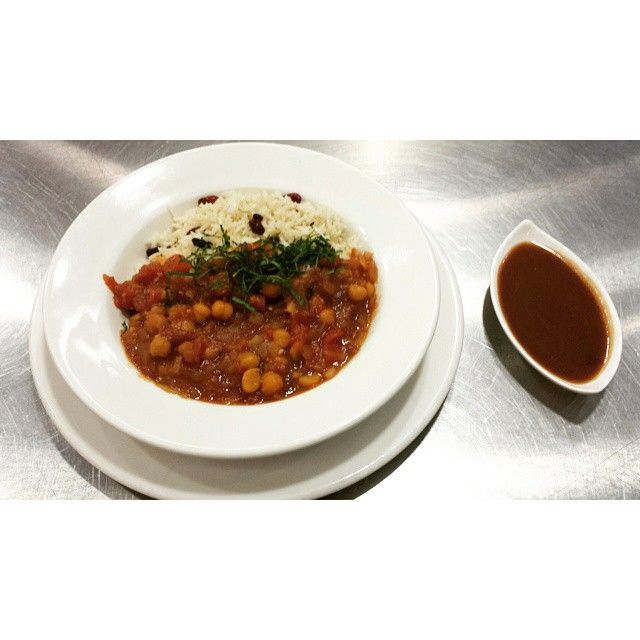 Northern Chickpea curry (channa Masala) and basmati rice with northern fragrant Spice Pullao and tamarin chutney sauce. by: chef rhog