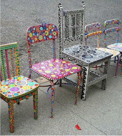 Colorful painted chairs. This is just plain fun! These could be used as special reading chairs.