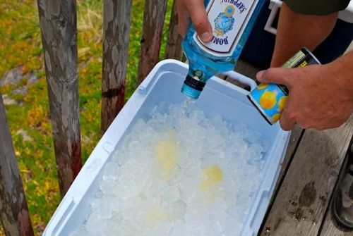 Combine 3 gallons of gin,7 cans of lemonade concentrate, 6 bunches of fresh mint in a large clean ice chest with a 20lb bag of ice. Stir, stir, stir, taste, taste, taste. Make night before so that some of the ice melts into the drink and flavors marry perfectly.