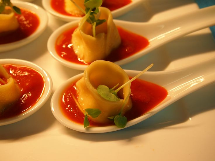 Goats Cheese Tortellini Canape, capsicum essence, baby herbs
