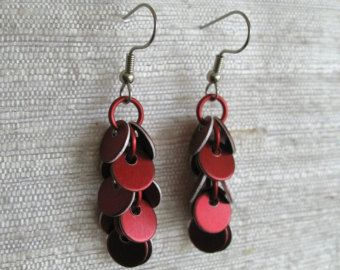 These delightful drops are incredibly lightweight and will add a pop of color to any outfit. A single anodized leaf dangles from a surgical steel French hook ear wire. The earrings measure about 1 long.    Aluminum is a great alternative to traditional metals. Aside from being light as a feather, aluminum is the only material thats 100% recyclable and endlessly recyclable. If youre ever tired of your earrings, you can drop it in the recycle bin, and the next day it could be part of a soda…