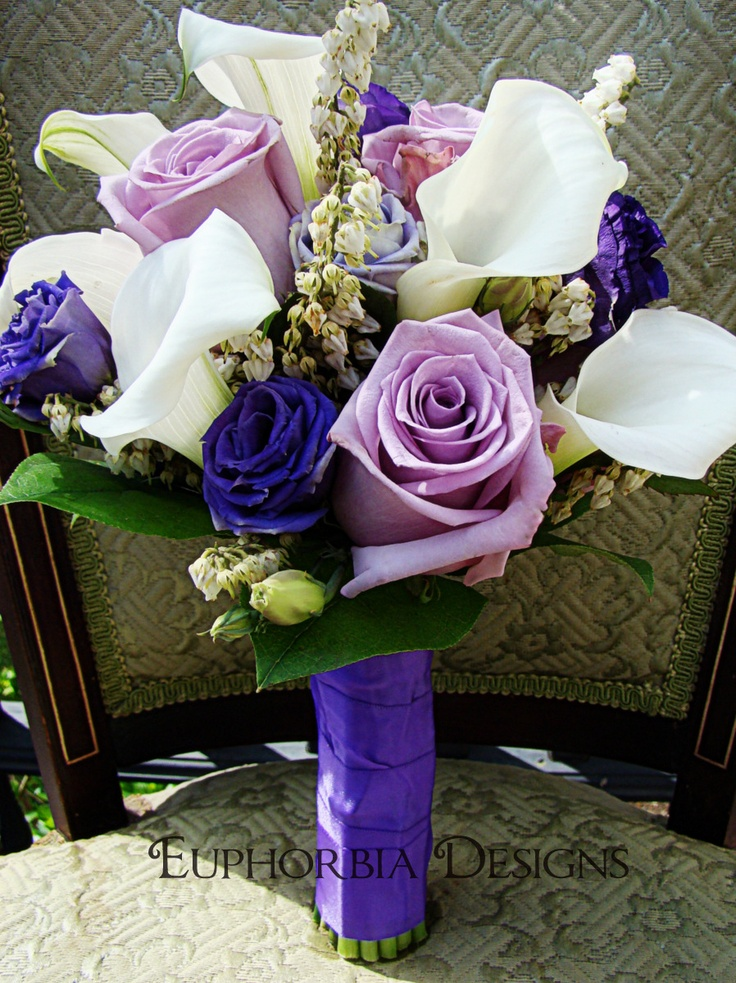 The Bridal Bouquet Of Purple Roses White Calla Lillies And Lizzyanthus Euphorbia Floral