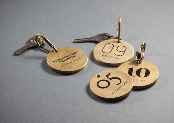 Logo and bronze keychains with mixed typographic detail for Tel Aviv hotel Townhouse designed by Koniak