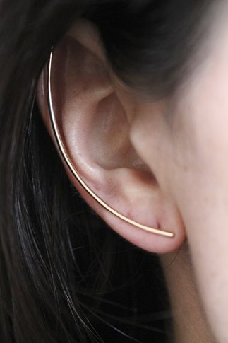 Designer: Lumo Stunningly simple solid Sterling Silver minimalist bar ear crawler provides an individualistic look. Ear crawler measures 2 inches long. Sold individually for one ear. Please choose t