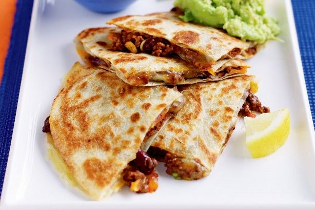 Quesadillas filled with spicy mince are delicious with a generous dollop of creamy avocado smash.