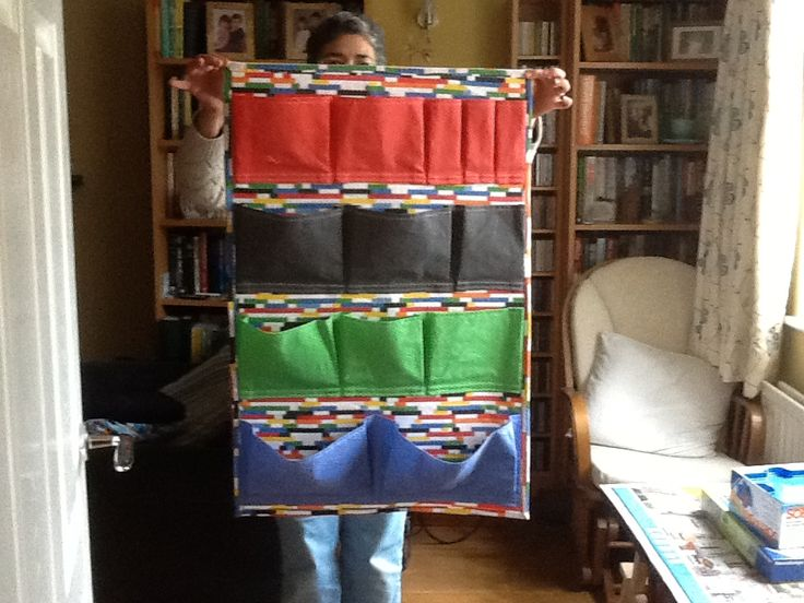 This is a door organiser for my nephew Connor.  I used this fantastic Lego fabric from Spoonflower.