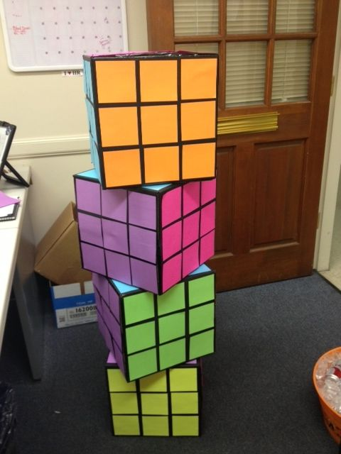 80's Party Rubix Cube decor.  12x12 boxes painted black, neon card stock cut into 3x3 pieces.  Glue or tape.