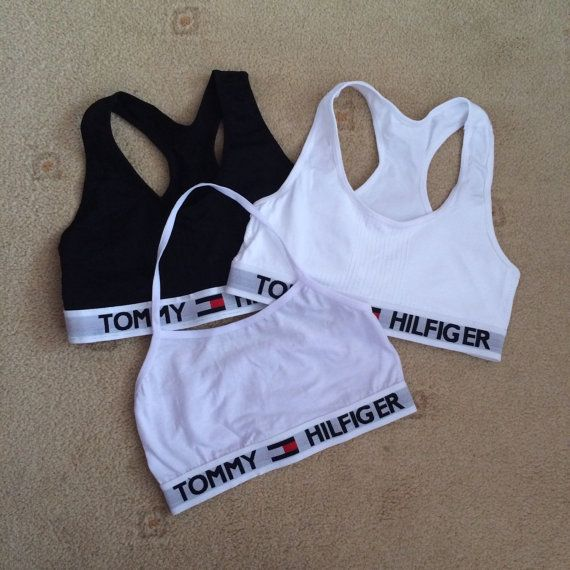 tommy Hilfiger reworked crop top. would fit sizes 6-10 because of the strechy material. black and white halter available ! ON HOLIDAY ..... ANY ORDERS