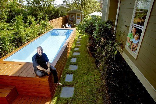 Dumpster repurposed into swimming pool for small backyard.